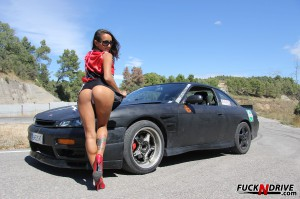 sexy latina babe excited by a fast car